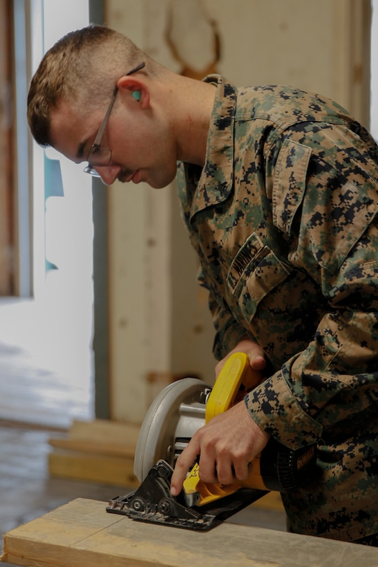 U.S. Marine Lance Cpl. Casey W. Holle, combat engineer with Engineer Company C, 6th Engineer Support Battalion, 4th Marine Logistics Group, practices using a circular saw power tool at a construction site during exercise Red Dagger at Fort Indiantown Gap, Pa., May 19, 2018.