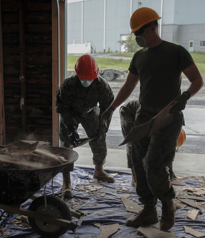 U.S. Marines with 6th Engineer Support Battalion, 4th Marine Logistics Group, gather old pieces dry wood at a construction site during exercise Red Dagger at Fort Indiantown Gap, Pa., May 20, 2018.