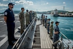 Sailors and Soldiers from the U.S., United Kingdom and Australia embarked aboard Military Sealift Command expeditionary fast transport ship USNS Brunswick (T-EPF 6), assigned to Pacific Partnership 2018 (PP18), man the rails as the ship arrives in Thailand, May 19. PP18's mission is to work collectively with host and partner nations to enhance regional interoperability and disaster response capabilities, increase stability and security in the region, and foster new and enduring friendships across the Indo-Pacific Region. Pacific Partnership, now in its 13th iteration, is the largest annual multinational humanitarian assistance and disaster relief preparedness mission conducted in the Indo-Pacific.