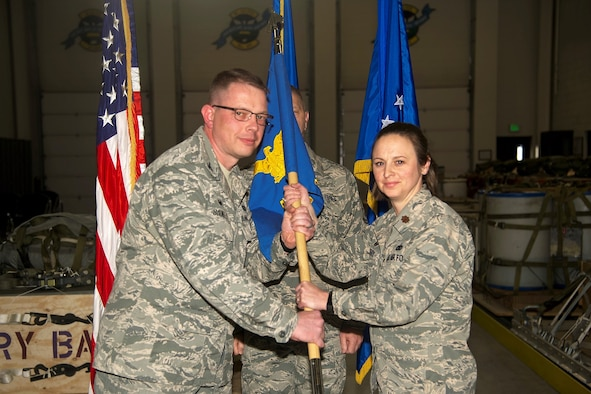 PETERSON AIR FORCE BASE, Colo. – Col. Richard Saunders, 302nd Mission Support Group commander, passes the 39th Aerial Support Squadron guidon to Maj. Emily Barry, the 39th APS commander, during the 39th APS Change of Command ceremony, May 5, 2018, at Peterson Air Force Base, Colorado. Barry took command of the squadron, Sept. 1, 2017, that provides Aerial Port operations including cargo, ramp and passenger services and airdrop support. (U.S. Air Force photo by Staff Sgt. Tiffany Lundberg)