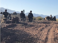 Marines of Transmissions Platoon, Company A provide security while establishing multichannel radio links.