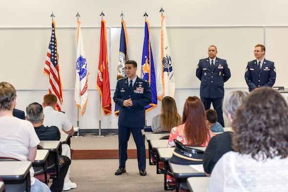 U.S. Air Force Col. Ricky Mills, 17th Training Wing commander, speaks to high school enlistees and their families during the Our Community Salutes ceremony, San Angelo, Texas, May 19, 2018. OCS was established in 2009 as a non-profit organization helping communities recognize, honor and support high school seniors who enlisted in the U.S. armed services after graduation. (U.S. Air Force photo by Senior Airman Randall Moose/Released)