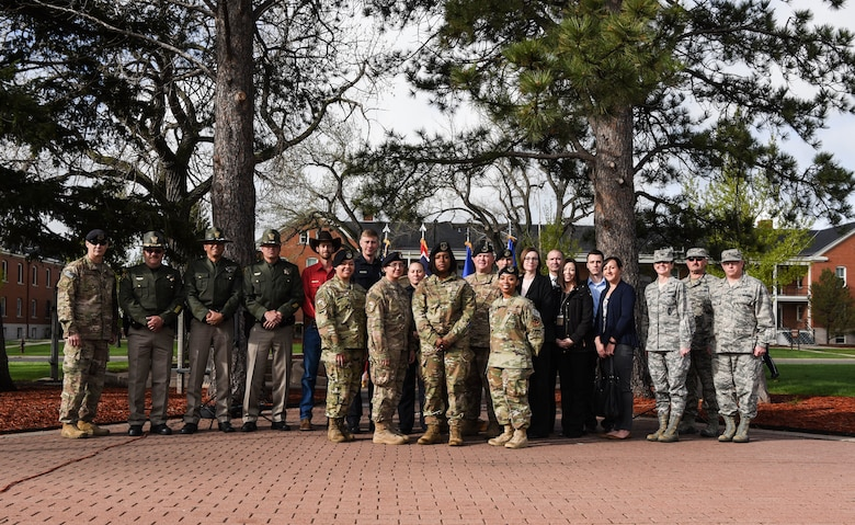 90th Missile Wing Leadership pose for a photo with Security Forces Defenders and local Cheyenne police officers for the opening of Police Week, May 14, 2018, on F.E Warren Air Force Base, Wyo. In 1962, President John F. Kennedy signed a proclamation which designated May 15 as Peace Officers Memorial Day and the week in which that date falls as Police Week. People all across the United States participate in various events which honor those who have paid the ultimate sacrifice. (U.S. Air Force photo by Airman 1st Class Braydon Williams)
