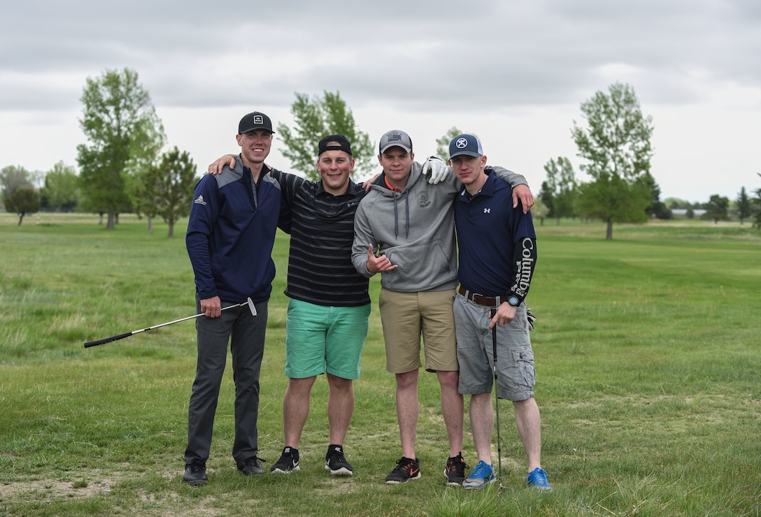 A four-man golf team from the 90th Tactical Response Force, pose for a group photo during the Police Week Security Forces golf tournament, May 18, 2018, on F.E. Warren Air Force Base, Wyo. Teams came out for a relaxed round of golf to end Police Week with a good time. In 1962, President John F. Kennedy signed a proclamation which designated May 15 as Peace Officers Memorial Day and the week in which that date falls as Police Week. People all across the United States participate in various events which honor those who have paid the ultimate sacrifice. (U.S. Air Force photo by Airman 1st Class Braydon Williams)