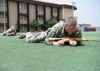 A security forces team performs a high crawl during a relay race at Osan Air Base, Republic of Korea, May 15, 2018. The relay race was hosted by the 51st Security Forces Squadron and was a part of the National Police Week 2018 events. The relay consisted of teams of performing various physical activities that mirror those of security forces training. (U.S. Air Force photo by Airman 1st Class Ilyana A. Escalona)