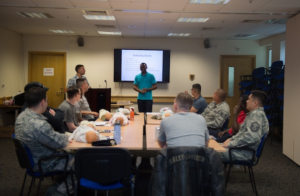 A Dads' Class 101 facilitator, and active duty Tech. Sgt., addresses a group of expecting fathers at the 48th Medical Group at Royal Air Force Lakenheath, England, May 9, 2018. The facilitator used his experience as a father to address participants' questions and lead hands-on parenting activities. (U.S. Air Force photo/Airman 1st Class Shanice Williams-Jones)
