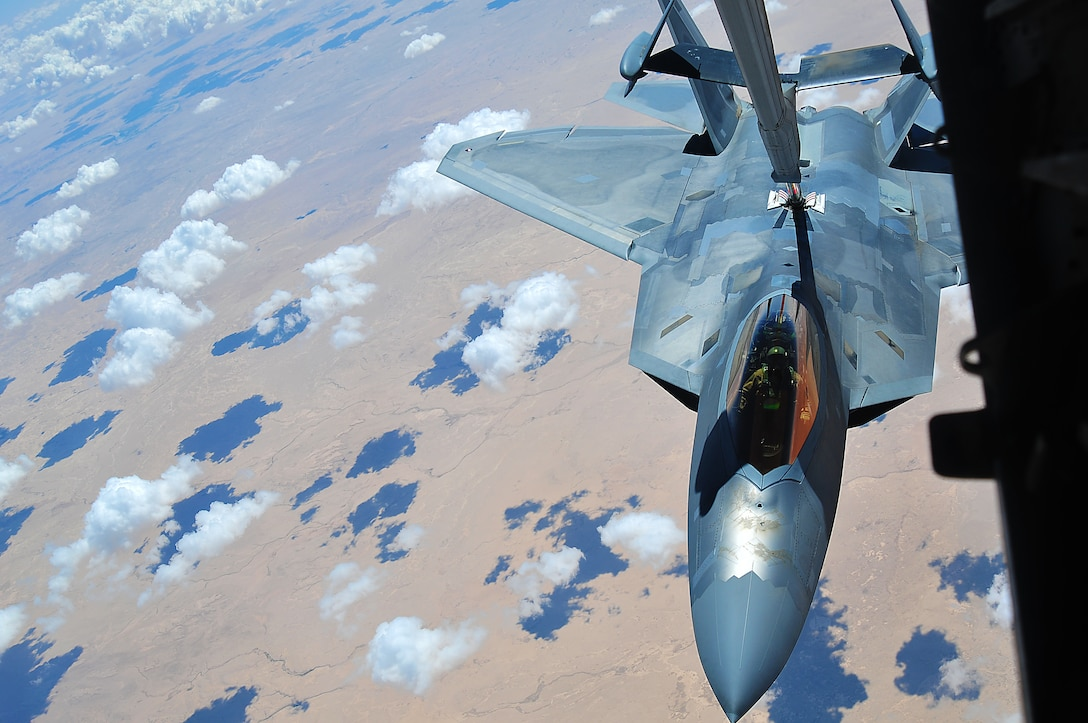 A 94th Fighter Squadron F-22 Raptor at the 380th Air Expeditionary Wing, Al Dhafra Air Base refuels mid-air by a 908th Air Refueling Squadron KC-10 Extender, May 16, 2018.  Air refueling is a vital component of flying operations, allowing the F-22 to stay airborne longer and support U.S. and coalition forces in the air and on the ground as a part of Operation Inherent Resolve.