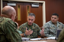 U.S. Marine Col. Michael Oppenheim, the commander of Special Purpose Marine Air-Ground Task Force - Southern Command, center, and Colombian Naval Infantry Lt. Col. Erick H. Del Rio, the SPMAGTF-SC deputy commander, right, talk to U.S. Navy Adm. Kurt W. Tidd, the commander of U.S. Southern Command, about the upcoming deployment of the MAGTF to Latin America during a confirmation brief in Doral, Florida, May 16, 2018. The Marines and sailors of SPMAGTF-SC will soon deploy to conduct security cooperation training and engineering projects alongside partner nation military forces in Central and South America. The unit will also be on standby to provide humanitarian assistance and disaster relief in the event of a hurricane or other emergency in the region.