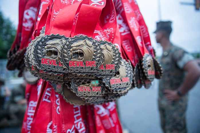 "Medals for the Devil Dog Double race of the 11th Annual Marine Corps Historic Half run are displayed at the finish line in Fredericksburg, Va., May 20, 2018. Runners of the Devil Dog Double ""go for two"" and scale Hospital Hill twice by participating in both the five mile Semper 5ive race and then the 13.1 mile Historic Half."