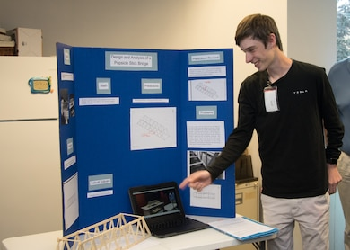 Local high school junior concludes his spring semester Gifted Independent Study Class at the Middle East District's Engineering Division, with a presentation on his project. He built a popsicle stick bridge and using available engineering analysis software, calculated the weight-bearing capacity before testing the bridge.