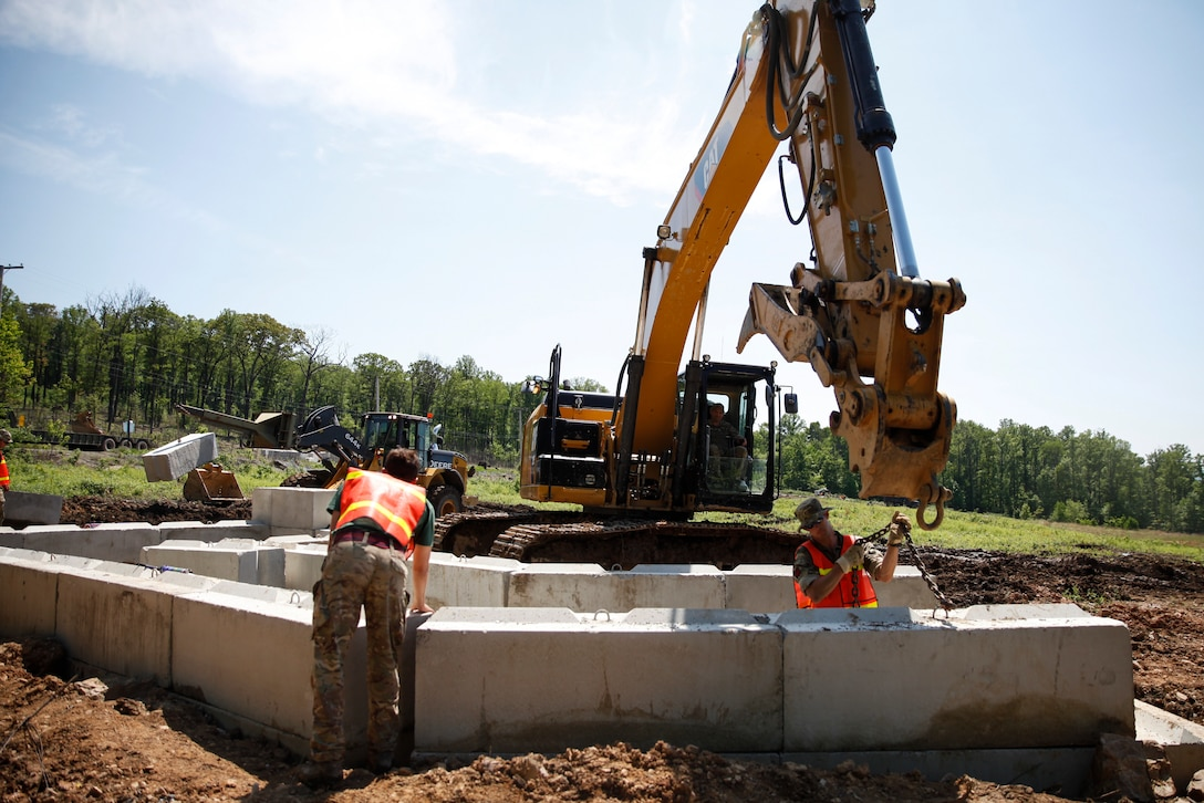 U.S. Marines with 6th Engineer Support Battalion, 4th Marine Logistics Group, and British commando's with 131 Commando Squadron Royal Engineers, British Army, build a bunker at a construction site during exercise Red Dagger at Fort Indiantown Gap, Pa., May 21, 2018.