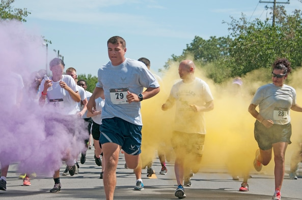 Participants run through vibrant clouds of powder during the 919th Special Operations Wing's first-ever Color Run May 5, 2018 at Duke Field, Fla