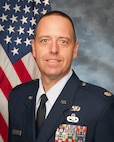 U.S. Air Force Maj. Scott Brochu, 158th Logistics Readiness Squadron operations officer, poses for an official photograph.