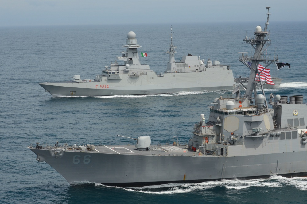 The guided-missile destroyer USS Gonzalez conducts a passing exercise with the Italian multimission frigate ITS Alpino in the Atlantic Ocean.