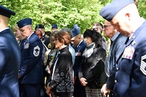 Civilians and military members bow their heads for prayer during the Kindergraves Memorial at Kaiserslautern Main Cemetery May 19, 2018. Participants prayed individually after being led in prayer by two different chaplains.