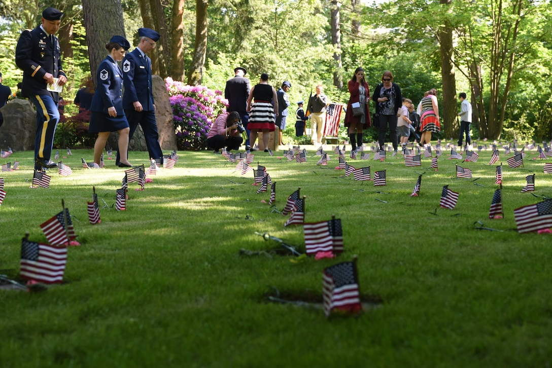 Civilians and military members pay respects to the 458 infants in the kindergraves, at Kaiserslautern Main Cemetery May 19, 2018. Although there are 458 infants laid to rest at the cemetery, there are only 452 burial plots.