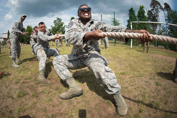 U.S. Airman participates in a tug-of-war contest during Police Week 2018 on Ramstein Air Base, Germany, May 15, 2018. Eight law enforcement units, including the 86th Security forces Squadron, the 569th U.S. Forces Police Squadron, and the 435th Contingency Response Group, competed against each other in tests of strength, endurance, and weapons handling.