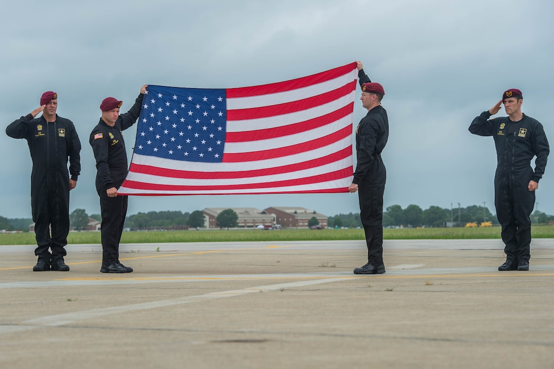 Members assigned to the U.S. Army Golden Knights, display an American flag during the opening ceremony at AirPower Over Hampton Roads JBLE Air and Space Expo at Joint Base Langley-Eustis, Virginia, May 19, 2018.