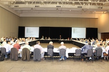 Members of the Missouri River Recovery Implementation Committee sit around a large table.