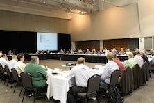 Members of the Missouri River Recovery Implementation Committee sitting around a large table.