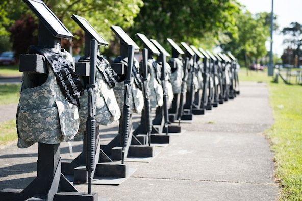 Guard mounts are on displayed at the base track at Royal Air Force Lakenheath, England, May 18, 2018. Each memorial display is to honor the fallen defenders in observance of National Police Week. (U.S. Air Force photo/ Airman 1st Class Shanice Williams-Jones)