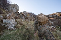 Marines and sailors with 4th Air Naval Gunfire Liaison Company, Force Headquarters Group, scale a mountain to get to their second checkpoint during a land navigation exercise in Durness, Scotland, April 30, 2018.