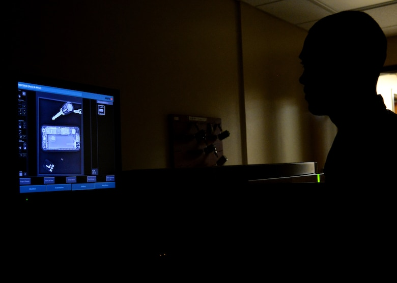 Staff Sgt. Ryan Gulland, a 28th Medical Support Squadron diagnostic imaging technician, looks over a test image on the image processor inside the 28th Medical Group at Ellsworth Air Force Base, S.D., May 11, 2018. Once an image is captured, a cassette is placed in the processor and the image generates on screen for review. (U.S. Air Force photo by Senior Airman Denise Jenson)