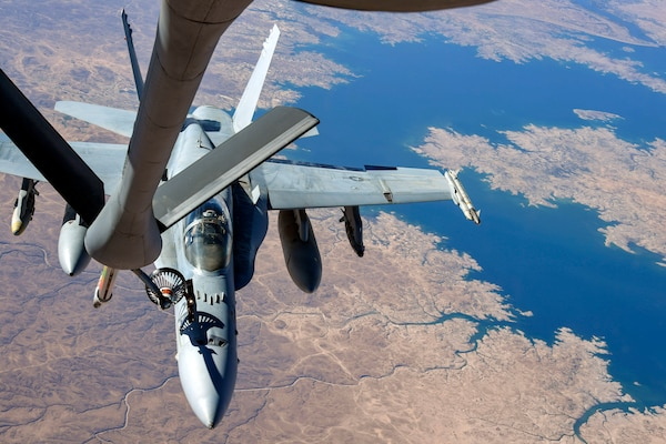 A Navy F-18 Super Hornet receives in-flight fuel from a KC-135 Stratotanker during an aerial refueling mission in support of Operation Inherent Resolve over Iraq, May 18, 2018. The KC-135 Stratotanker is assigned to the 28th Expeditionary Air Refueling Squadron. Air Force photo by Staff Sgt. Keith James