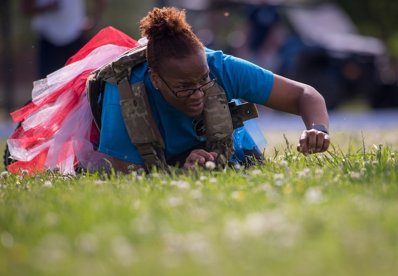 U.S. Air Force Lt. Col. Alisha Smith, 633rd Medical Support Squadron commander, low crawls during the National Police Week Defenders' Challenge at Joint Base Langley-Eustis, Virginia, May 16, 2018.