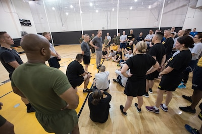 Army Command Sgt. Maj. John W. Troxell, senior enlisted advisor to the chairman of the Joint Chiefs of Staff, hosts a physical training session with Deputy Defense Secretary Patrick M. Shanahan and service members from across the joint force at the inaugural DoD Readiness and Resilience Workshop at Fort McNair in  Washington.