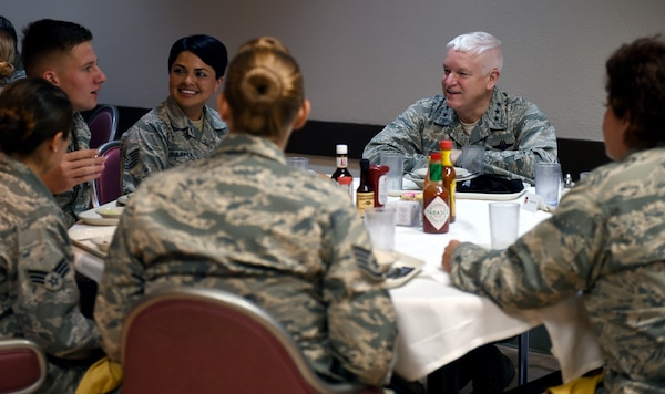 Lt. Gen. L. Scott Rice, Air National Guard Director, visits with airmen from the 149th Fighter Wing during a lucheon at the Live Oak dining facility at Joint Base San Antonio-Lackland May 19.
