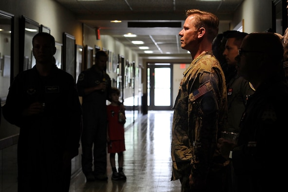 Wearing the Army combat uniform, Lt. Col. Jason Powell, Air Education and Training Command deputy director for safety, leads the roll call for the NATO Air Training Command Afghanistan, NATC-A NINE, April 27, 2018, Randolph AFB, Texas. Powell was on the next rotation that followed this tragic event and has flown with the 99th FTS for the last four years. Among the victims was Maj. Jeff 'Oz' Ausborn, who was deployed from the 99th FTS. (U.S. Air Force photo by Tech. Sgt. Ave I. Young)
