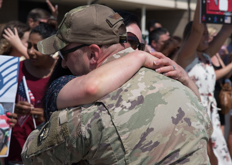 Air Force reservists with the 403rd Wing, Keesler Air Force Base, Mississippi, are welcomed home by their loved ones. Several 403rd Wing members and 815th Airlift Squadron aircrews recently returned from a deployment to Southwest Asia in support of Operations Freedom Sentinel and Inherent Resolve. (U.S. Air Force photo/Maj. Marnee A.C. Losurdo)