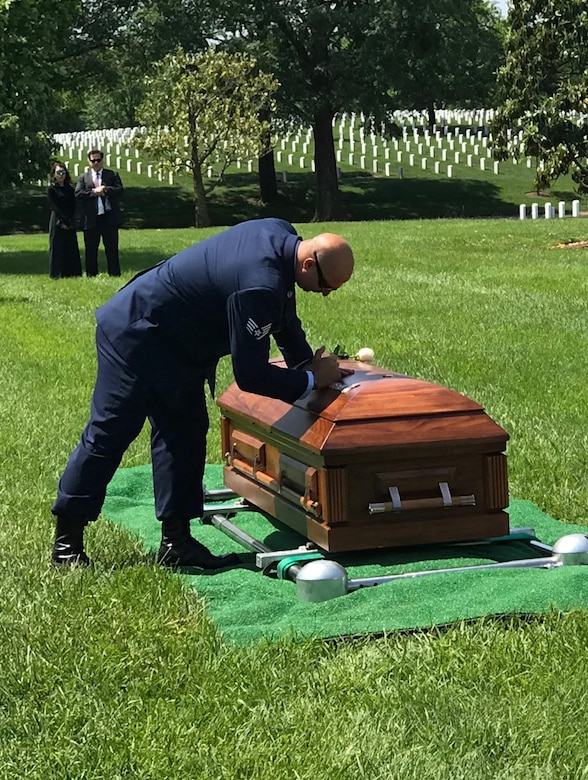 Staff Sgt. Brandon Forshaw, pararescueman, 308th Rescue Squadron, along with other colleagues, friends and loved ones, paid final respects to fallen pararescueman Staff Sgt. Carl Enis at Arlington National Cemetery May 21, 2018. In a time-honored tradition, members of the elite Guardian Angel triad of pararescue, press their pararescue flash taken from their maroon berets, into the lid of the casket to honor their fallen teammate. Enis was providing combat rescue support for Inherent Resolve, when he, along with six other Airmen, was killed in an HH-60G Pave Hawk helicopter crash in Anbar Province, Iraq, March 15, 2018. The Guardian Angel triad consists of pararescuemen, combat rescue officers and SERE or survival specialists who are expert swimmers, SCUBA divers, mountain climbers, parachutists, marksmen and trauma medics who are uniquely capable of performing rescues anywhere in the world. The 308th Rescue Squadron is part of the 920th Rescue Wing at Patrick Air Force Base, located in Cocoa Beach, Florida. (Courtesy photo)
