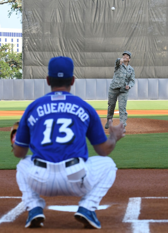 Col. Debra A. Lovette, 81st Training Wing commander, throws the first pitch to Mike Guerrero, Biloxi Shuckers manager, during a Biloxi Shuckers baseball game, in Biloxi, Mississippi, May 17, 2018. Lovette also participated in other pre-game festivities. (U.S. Air Force photo by Kemberly Groue)