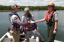 Kansas City District, Corps of Engineer Park Ranger Gina Pate provided boating safety information to these two boaters at Stockton Lake May 18, 2018.