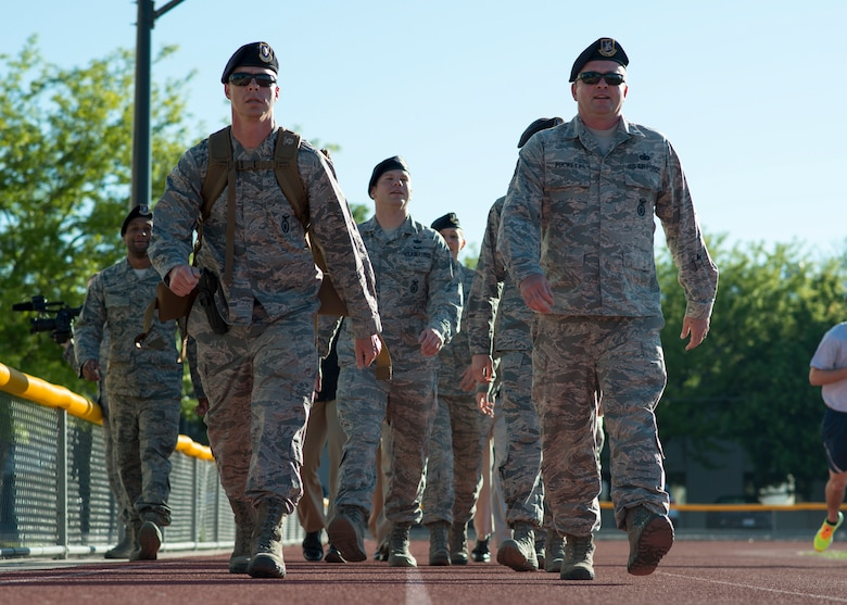 Defenders from the 366th Security Forces Squadron ruck march around the base track May 14, 2018, at Mountain Home Air Force Base, Idaho. The ruck march was performed 24 hours a day, May 14-18, in honor of the 14 defenders who lost their lives since 9/11.. (U.S. Air Force Photo by Airman 1st Class JaNae Capuno)