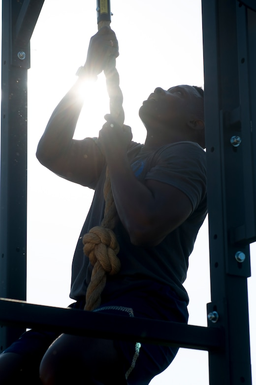 Staff Sgt. Ramir Looney, 366th Security Forces Squadron investigator, performs a rope climb during the National Police Week memorial workout, May 15, 2018, at Mountain Home Air Force Base, Idaho. The memorial workout included 14 workouts and 14 repetitions to honor the fallen defenders. (U.S. Air Force Photo by Airman 1st Class JaNae Capuno)
