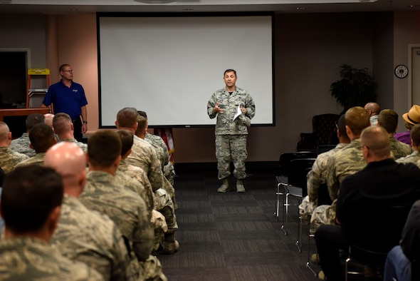 Lt. Col. David Linton, 436th Aerial Port Squadron commander, briefs his Airmen during an operational safety review day May 18, 2018, at Dover Air Force Base, Del. Commander-led forums were conducted to gather feedback from Airmen who execute the Air Force's flying operations and challenge Airmen to identify issues that may cause a future mishap. (U.S. Air Force photo by Airman 1st Class Zoe M. Wockenfuss)