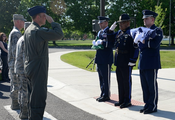 Col. Johan Deutscher, 141st Air Refueling Wing commander, renders a salute to the colors presented by members of the Fairchild Air Force Base Honor Guard and a law enforcement officer during a National Police Week Memorial Retreat Ceremony at Fairchild AFB, Washington, May 16, 2018. A retreat ceremony was held in remembrance of fallen law enforcement members with the U.S. flag being retired.