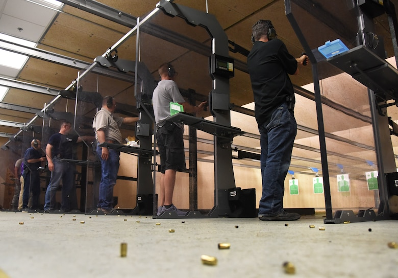 Keesler personnel and members of the local law enforcement participate in the 81st Security Forces Squadron law enforcement team competition shoot in the indoor firing range at Keesler Air Force Base, Mississippi, May 16, 2018. The event was held during National Police Week, which recognizes the service of law enforcement men and women who put their lives at risk every day. (U.S. Air Force photo by Kemberly Groue)