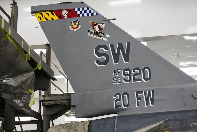 The 20th Fighter Wing commander's F-16CM Fighting Falcon displays a new tail scheme honoring the Wild Weasel mission.
