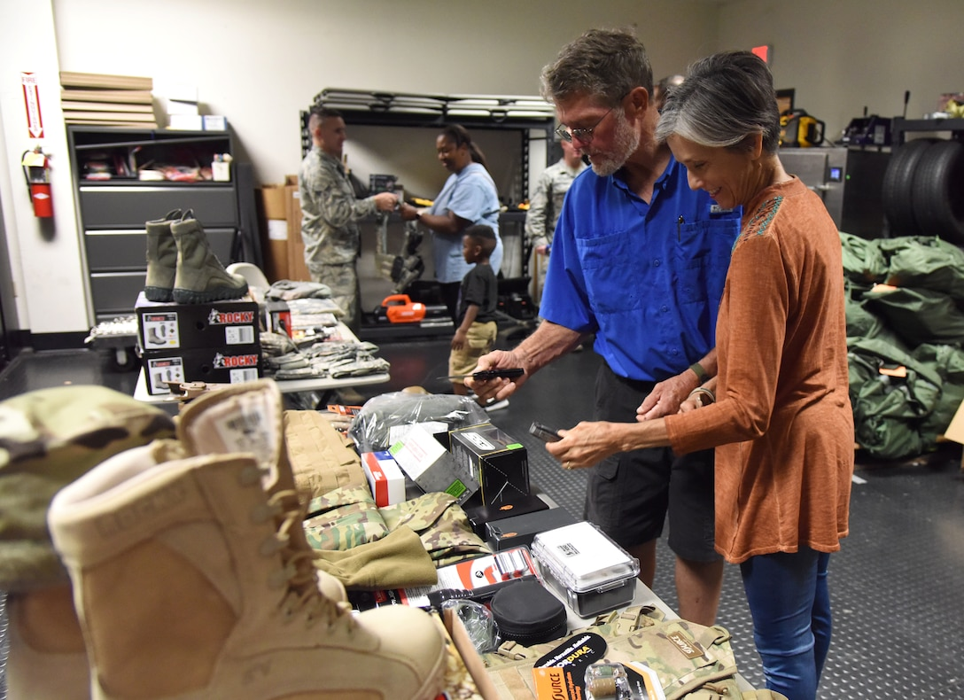 Brad and Cindy Bordes, grandparents of U.S. Air Force Airman Noah Hill, 81st Security Forces Squadron entry controller, inspect uniforms and equipment worn by 81st SFS Airmen during the 81st SFS open house at Keesler Air Force Base, Mississippi, May 17, 2018. The open house allowed individuals to walk through a day in the life of a defender. The event was held during National Police Week, which recognizes the service of law enforcement men and women who put their lives at risk every day. (U.S. Air Force photo by Kemberly Groue)