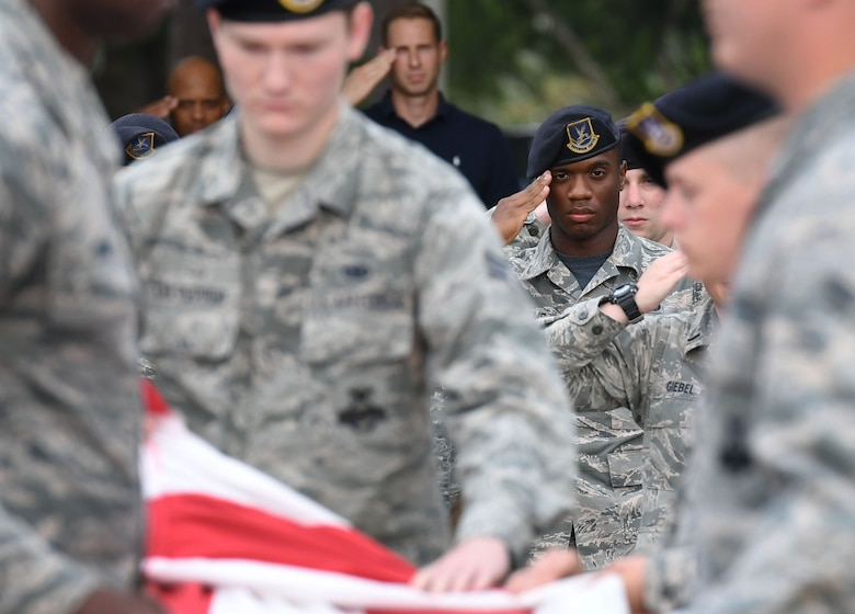 U.S. Air Force Senior Airman Matthew Williams, 81st Security Forces Squadron entry controller, renders a salute during the 81st SFS retreat ceremony at Keesler Air Force Base, Mississippi, May 18, 2018. The event was held during National Police Week, which recognizes the service of law enforcement men and women who put their lives at risk every day. (U.S. Air Force photo by Kemberly Groue)