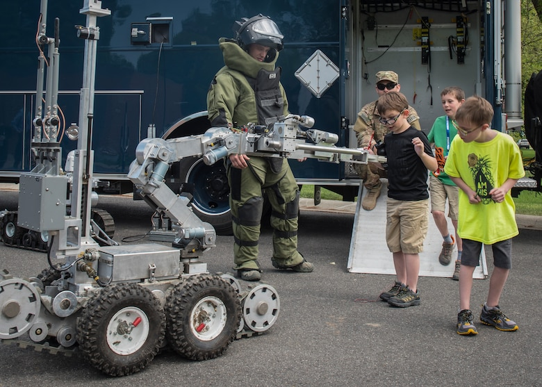 Airman 1st Class Kyle Riley, 92nd Civil Engineer Squadron Explosive Ordnance Disposal apprentice, shows Michael Anderson Elementary student's EOD tools during the National Police Week Law Enforcement Exposition at Fairchild Air Force Base, Washington, on May 16, 2018. The 92nd CES EOD, military working dogs and the Spokane Police Department provided children with hands-on demonstrations.
