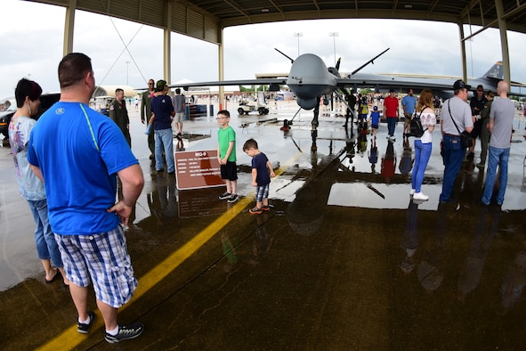 Airpower Over Hampton Roads spectators check out the MQ-9 Reaper at Joint Base Langley-Eustis, Virginia, May 20, 2018. Cloudy skies and rain did not deter visitors from paying a visit to JBLE over the air show weekend. (U.S. Air Force photo by Airman 1st Class Haley Stevens)