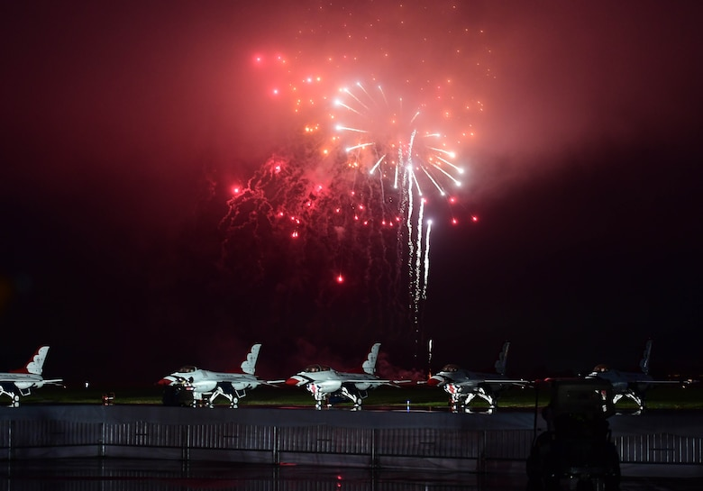 Fireworks are set off over the U.S. Air Force Thunderbirds aerial demonstration team during the Airpower Over Hampton Roads air show at Joint Base Langley-Eustis, Virginia, May 18, 2018.  This performance marked the first Thunderbirds demonstration since the start of this air show season. (U.S. Air Force photo by Senior Airman Christian Clausen)