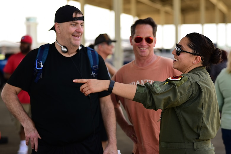 Tech. Sgt. Anna, 489th Attack Squadron sensor operator, explains various MQ-9 Reaper capabilities at Joint Base Langley-Eustis, Virginia, May 20, 2018. MQ-9 pilots, sensor operators and maintenance Airmen travel to air shows like Airpower Over Hampton Roads to help people understand the mission of the Remotely Piloted Aircraft enterprise. (U.S. Air Force photo by Airman 1st Class Haley Stevens)
