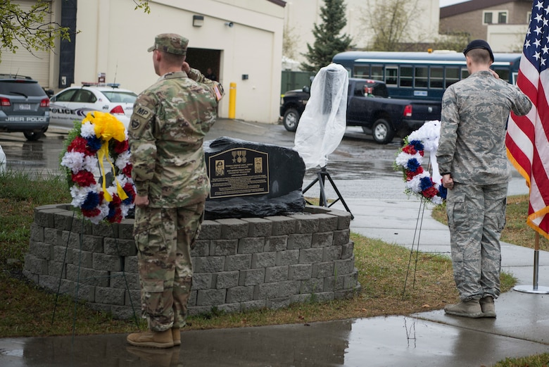 Members of Joint Base Elmendorf-Richardson salute memorial wreaths at the closing ceremony for Police Week on JBER, Alaska, May 18, 2018. National Police Week is a congressionally honored week for law enforcement personnel across the nation and around the world who have made the ultimate sacrifice in the line of duty.
