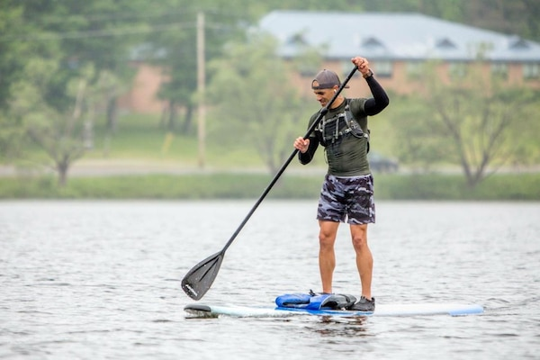 Sgt. 1st Class Mark Jones, infantryman, Army Mountain Warfare School, Vermont National Guard, practices paddle boarding for physical fitness training.